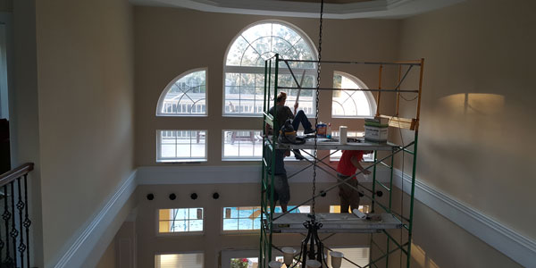 crystal clear workers working on window