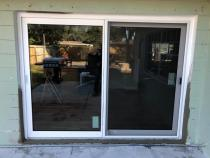 Converting window to sliding glass door! Like the idea?! Call now and schedule appointment for your free estimate 727-210-3506